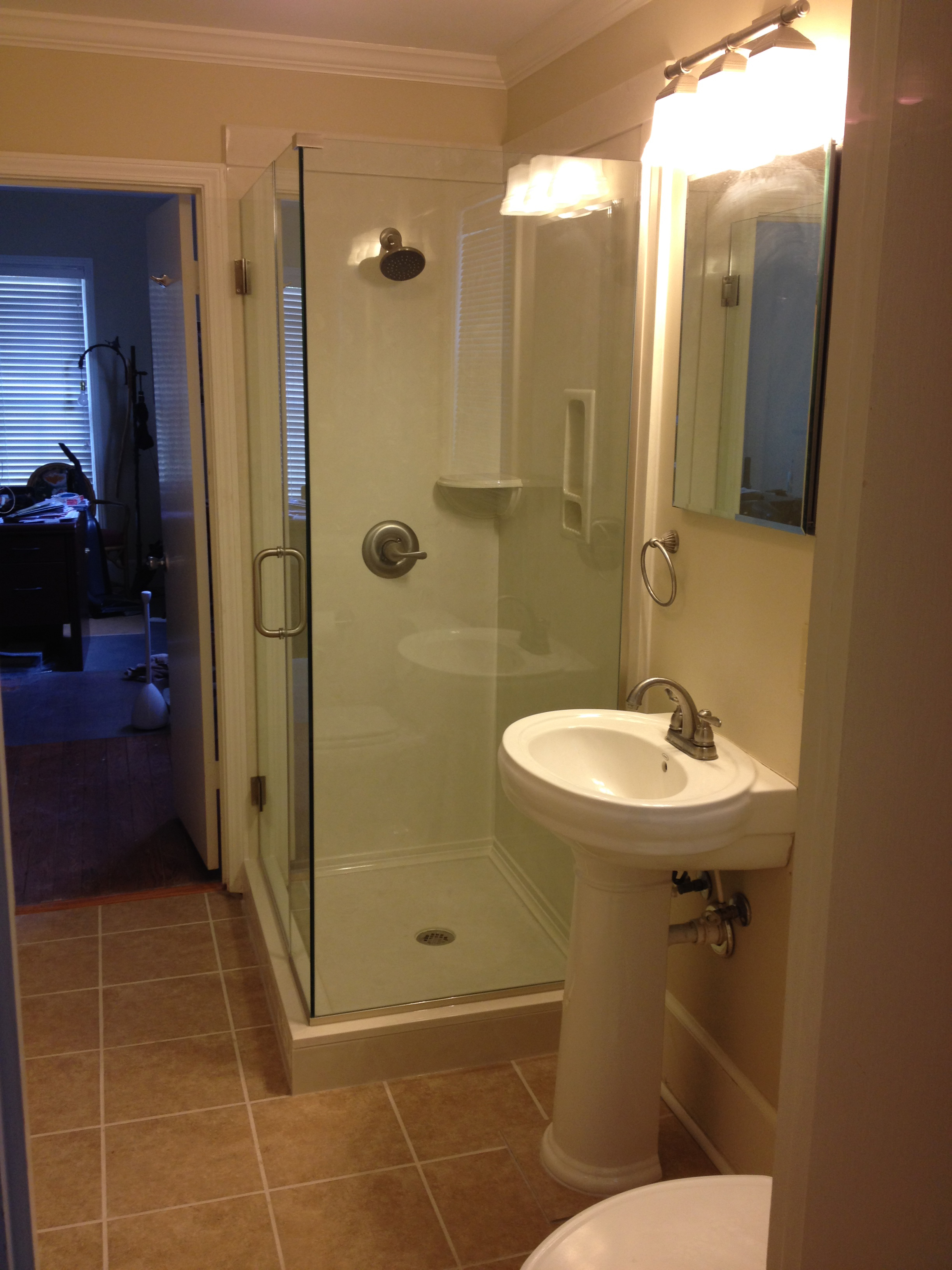 "Small corner shower with a nice ""Heavy Glass"" shower door"