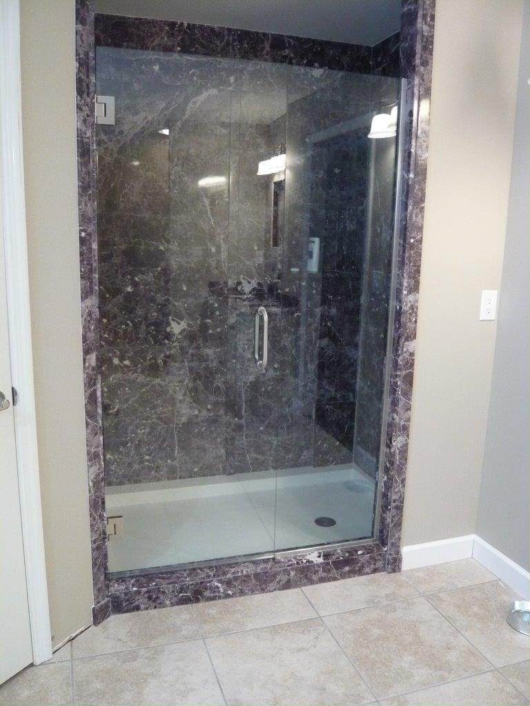 "TruStone Shower with frameless ""Heavy Glass"" door"